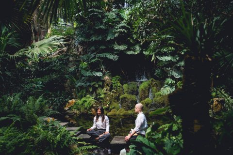 a man and a woman meditating amidst nature