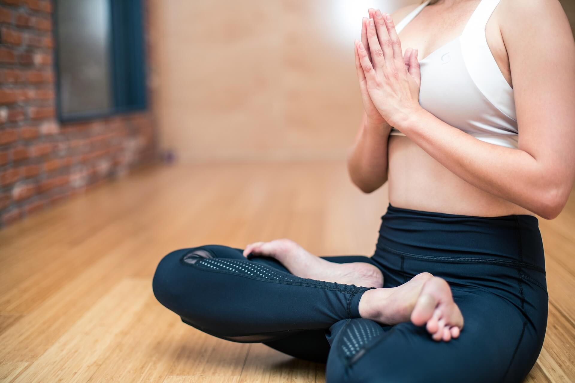 A woman sitting in the lotus position